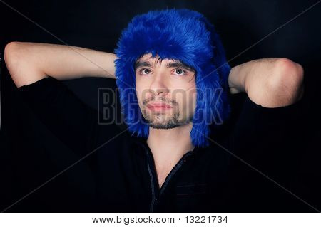 Young Caucasian Man In A Blue Winter Hat