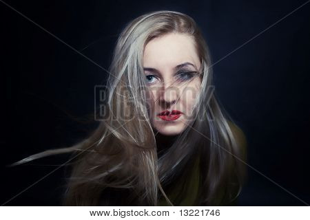 Woman With Hair Fluttering In Wind Closeup