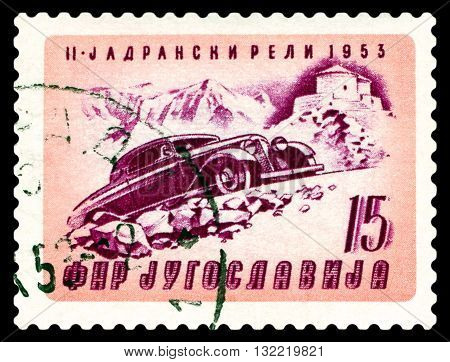 STAVROPOL RUSSIA - MARCH 30 2016: a stamp printed in Jugoslavia shows rally car. Automobile Climbing Mt. Lovcen cirka 1953