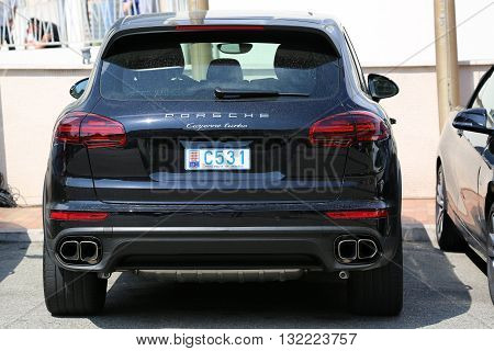 Monte-Carlo Monaco - May 18 2016: Luxury Black SUV Porsche Cayenne Turbo Parked in Front of the Fairmont Monte Carlo Hotel