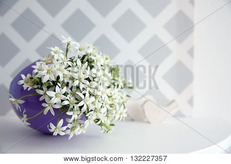 Bouquet of little white flowers on light background