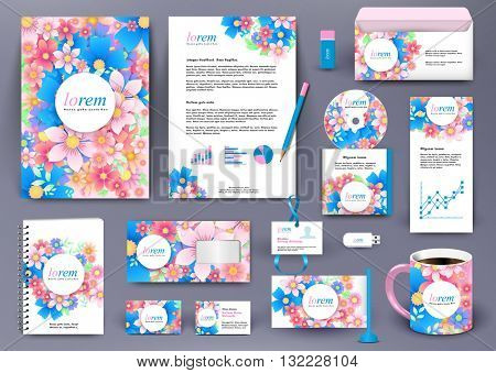 Professional branding design kit with floral elements. Blue, pink, red flowers. Business stationery mockup with badge, folder, cup, pennant, letter.