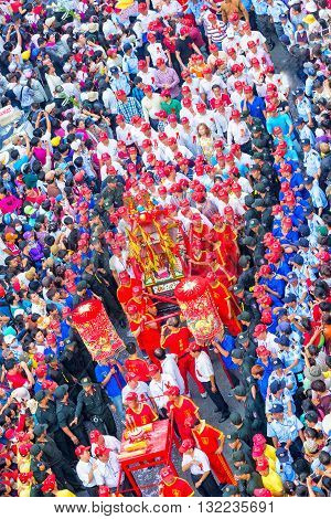 Binh Duong, Vietnam - February 22nd, 2016: Festival Chinese Lantern with colorful procession carrying censer goddess bless business is protected around march on road to pagoda in Binh Duong, Vietnam