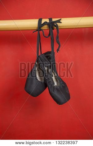 Ballet Shoes Hanging From Barre