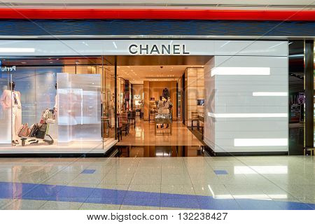 DUBAI, UAE - APRIL 08, 2016: Chanel store at Dubai International Airport. Dubai International Airport is the primary airport serving Dubai, United Arab Emirates