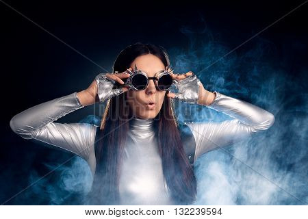 Surprised Woman in Silver Costume and Steampunk Glasses