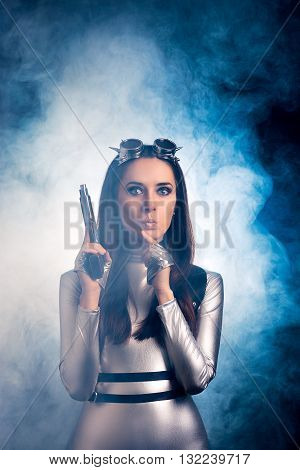 Surprised Woman in Silver Space Costume Holding Pistol Gun