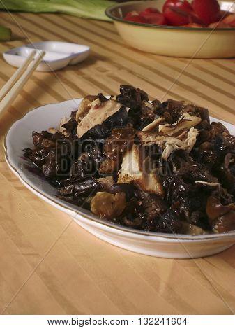 Chinese dining Cloud ear fungus stir-fry pork meat home make dish cuisine.