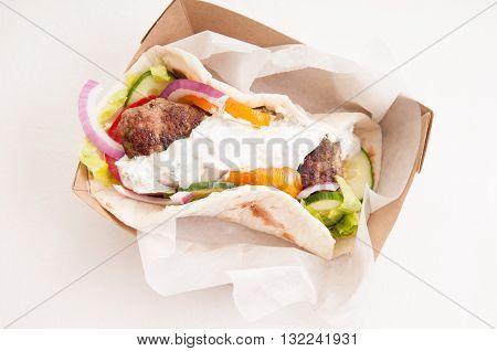 delicious flatbread wrap koobideh iranian skewer with fresh vegetables and tzatziki sauce