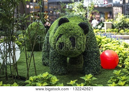 Laval, Canada - May 26, 2016:Beautiful garden decoration in Carrefour Laval Tropical Botanical Garden. Banda made by plants in Tropical Botanical Garden