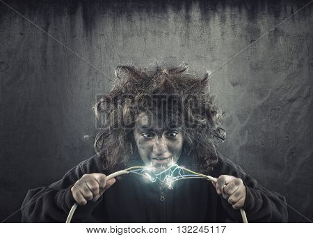 Young girl with messy hair being shocked by electric cable