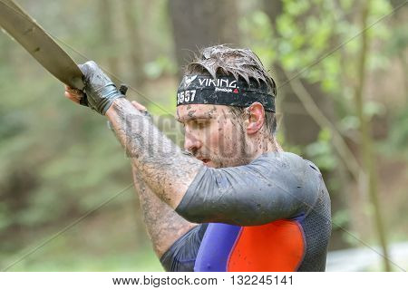 STOCKHOLM SWEDEN - MAY 14 2016: Man trying to maintain his balance on a slack rope in the obstacle race Tough Viking Event in Sweden May 14 2016