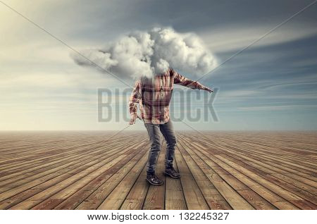 Teenager having his head covered by a cloud