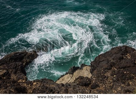 Sea water whirpool on the rocky coast in Ajuy, Parque Rural de Betancuria in Fuerteventura, Canary Island, Spain