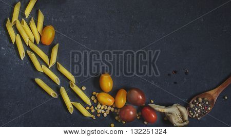 products for cooking pasta - pasta, tomatoes, cherry tomatoes, mushrooms, peppers,