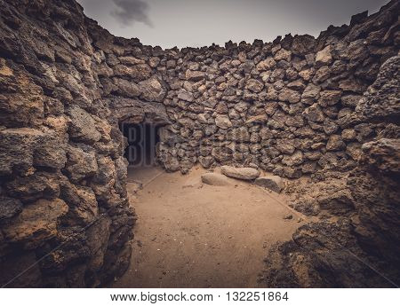 Old home entrance in an archaeological site of an old aboriginal village in Fuerteventura, Canary Islands, Spain