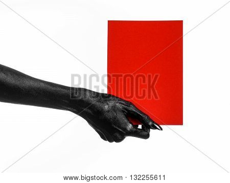Halloween And Gothic Theme: The Black Hand Of Death Holding A Blank Red Card Isolated On A White Bac