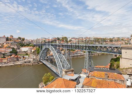 PORTO PORTUGAL - MAY 25 2016: Double-decked Dom Luis I Bridge over Douro River in the historical part of Porto city (UNESCO site) Portugal. Work of architect Teophile Seyrig 1886