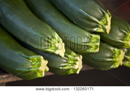Fresh organic courgettes on a wooden table