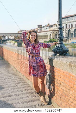 Happy Woman Walking Along The Embankment Near Ponte Vecchio