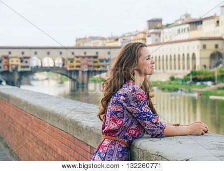 Portrait Of Pensive Woman On Embankment Near Ponte Vecchio