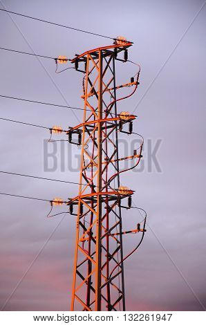 Spanish power pylon in the early morning sunshine Costa del Sol Malaga Province Andalusia Spain Western Europe.