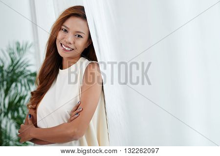 Attractive Filipino woman smiling and looking at camera