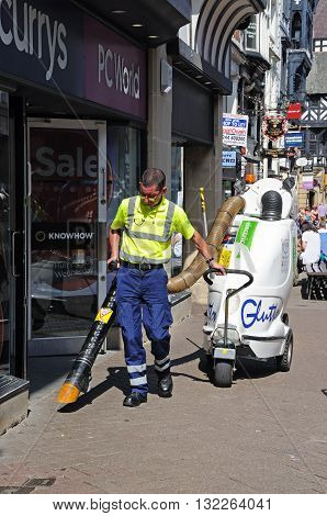 CHESTER, UK - JULY 22, 2014 - Street cleaner along Eastgate Street Chester Cheshire England UK Western Europe, July 22, 2014.