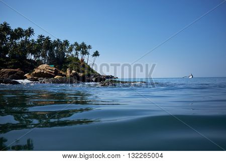 landscape of tropical beach with rocks, South Goa, India