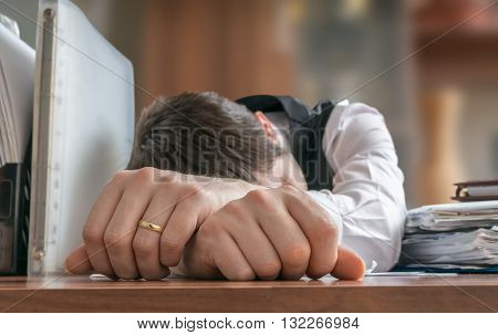 Lazy Businessman Or Layer Is Sleeping On Desk In Office.