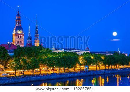 Old Town Of Riga With Reflection In Daugava River At Night. Riga, Latvia