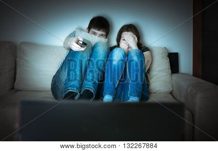 Young Scared Couple Is Watching Horror On Tv.