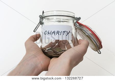 Hands Hold Jar With Coins. Collection For Chariry.