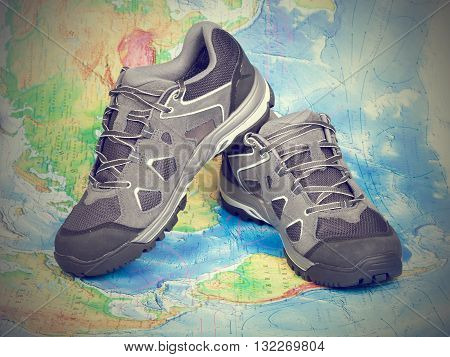 Walking Trekking Shoes On The World Map.