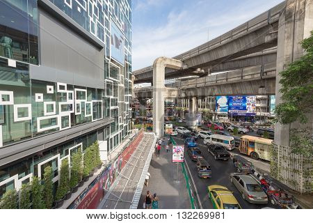 Bangkok Thailand - May 29 2016: Traffic outside the new mall called 'Siam Discovery' in Bangkok city. The sky train rail cross beside. This place is crowded day and night.