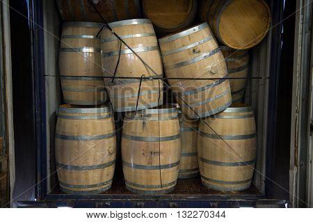 Wine Barrels Stacked In Truck ,loading Dock, Bordeaux Vineyard