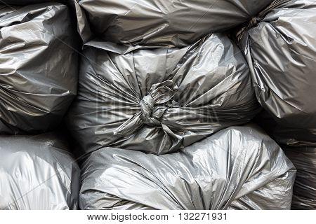 Close up pile of plastic black garbage bags