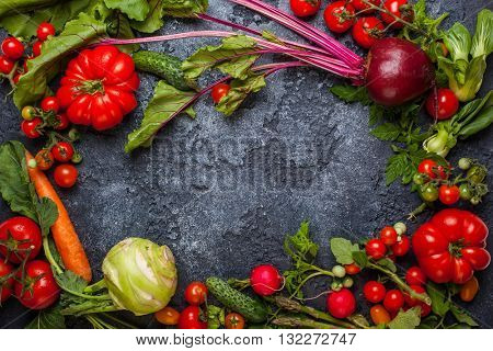 Fresh different vegetables  on  a black background. Top view