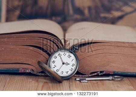 Old Vintage pocket watch on old books.