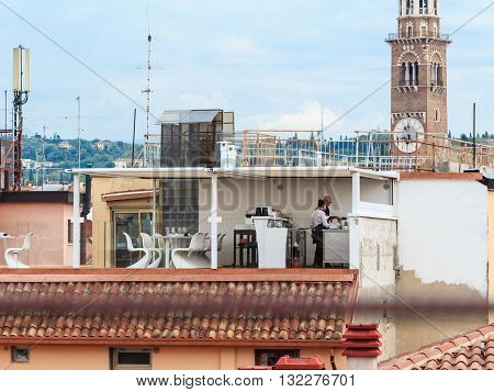 Verona Italy September 26 2015: Small cafe on the roof of the house on Via Anfiteatro in front Arena in Verona in Verona Italy