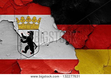 Flags Of Berlin And Germany Painted On Cracked Wall