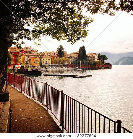 Small town of Varenna. Lake Como, Italy. Autumn. Walking along the lake Como. Aged photo. City view. Varenna, Lake Como, Italy.