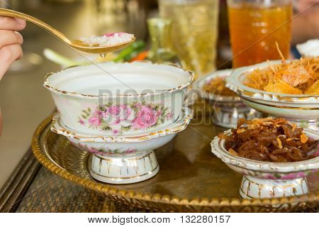 Cooked rice in jasmine water (sometime in rose water) and ice served with side dishes or named in Thai that