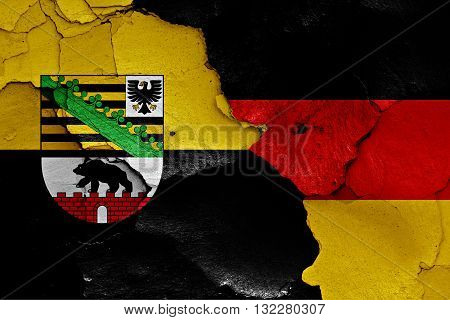 Flags Of Saxony Anhalt And Germany Painted On Cracked Wall