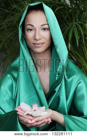 Care. Woman in green fabric