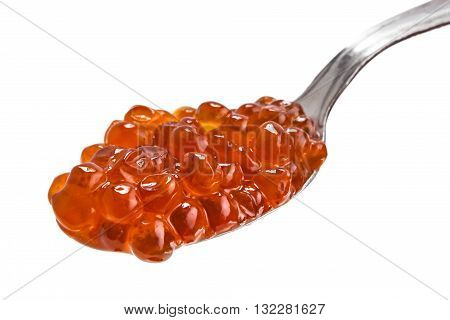 Red caviar in spoon on a white background. Gourmet food close up