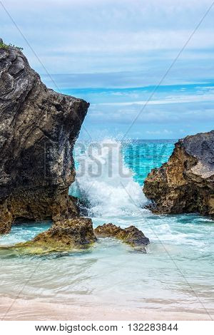 Waves break over the rock formations at Horseshoe Bay Beach in Bermuda.