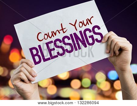 Count Your Blessings placard with night lights on background