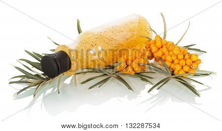 Bunches sea buckthorn, a bottle with scrub isolated on white background.
