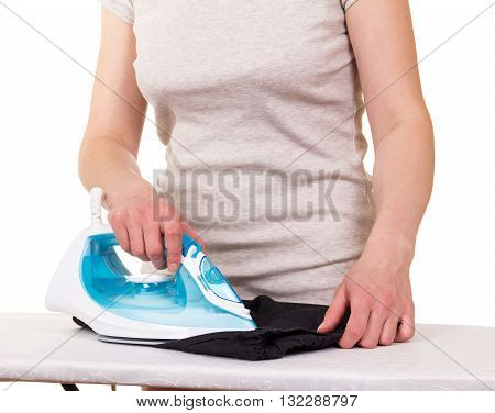 Steam iron in the hands of women and ironing clothes on a white background.